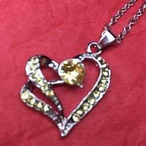 Silver tone jeweled heart necklace